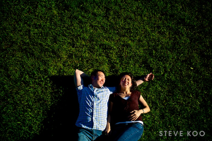 lying-on-grass-engagement-photo